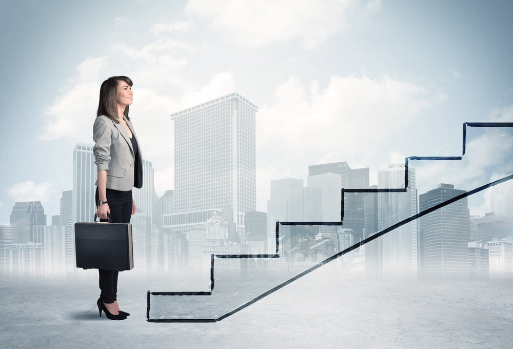 Business person in front of a staircase, city on the background.jpeg