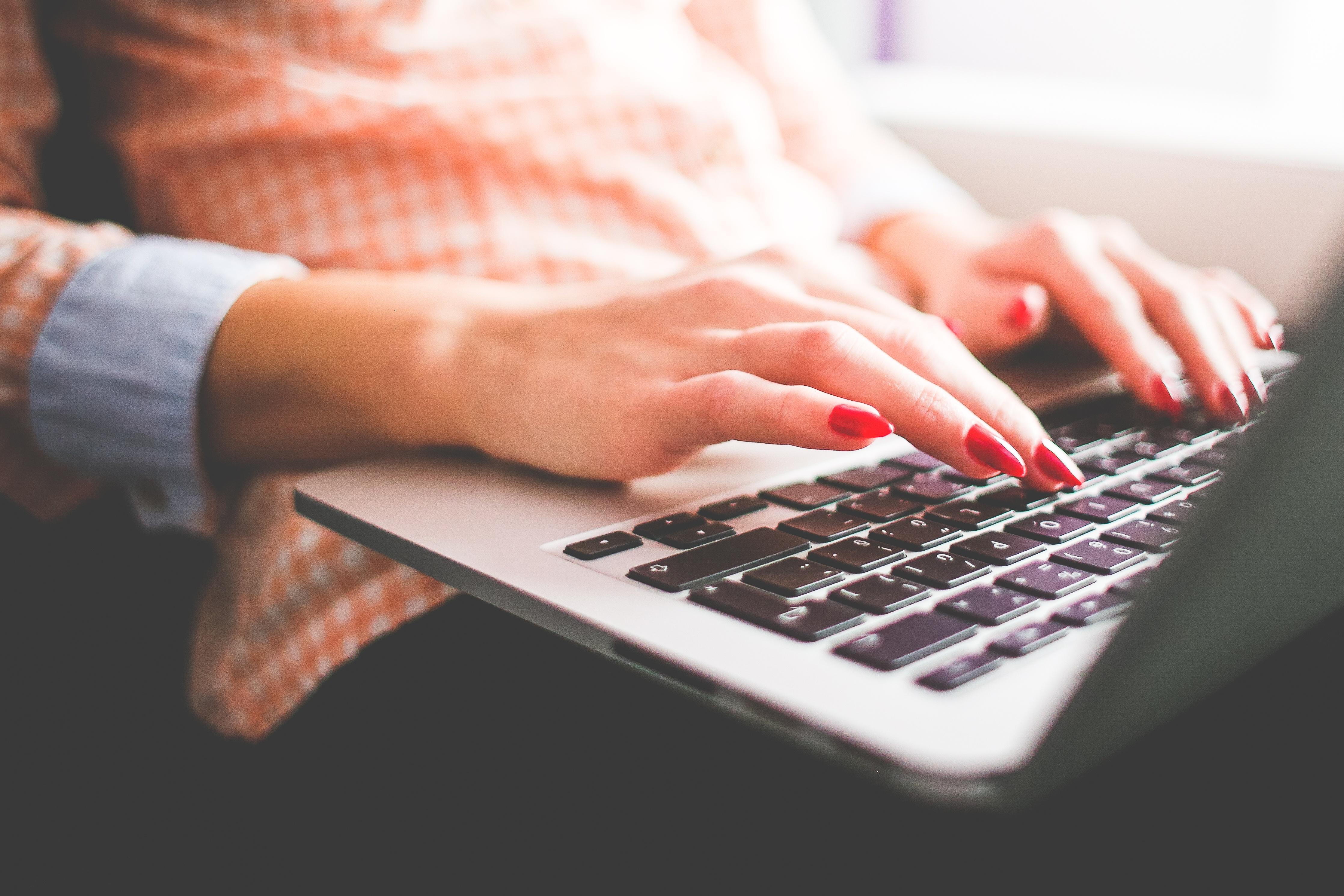 girl-typing-on-her-macbook-pro-close-up-picjumbo-com.jpg