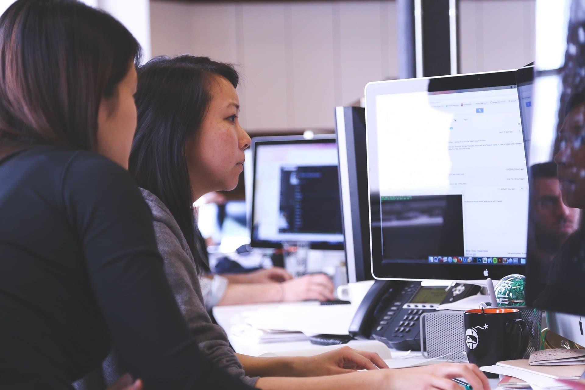 women-monitoring-computer-screens