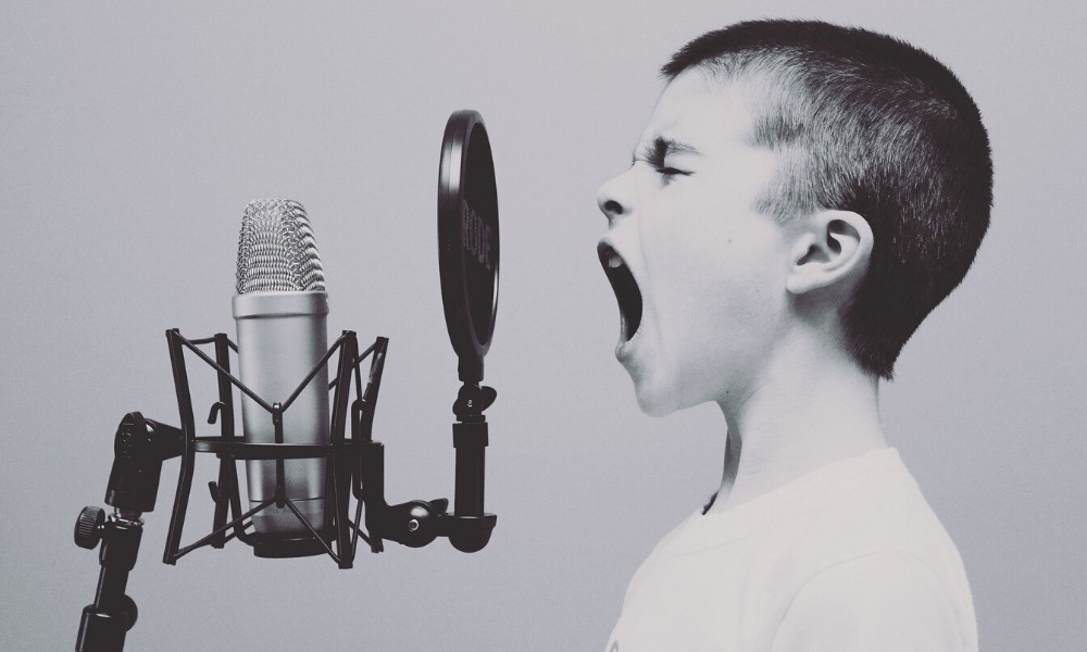 boy-yelling-into-a-microphone